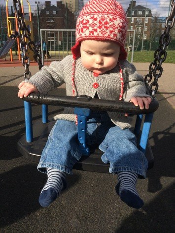 Daniel on the swings at Talacre Gardens
