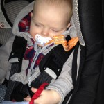Daniel sleeping in the car-seat