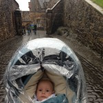 Thomas looking uncertain on the cobblestone street inside the castle